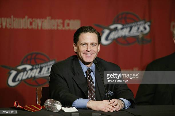 Dan Gilbert smiles during a press conference to announce the NBA has approved the purchase of the Cleveland Cavaliers by an investor group led by...