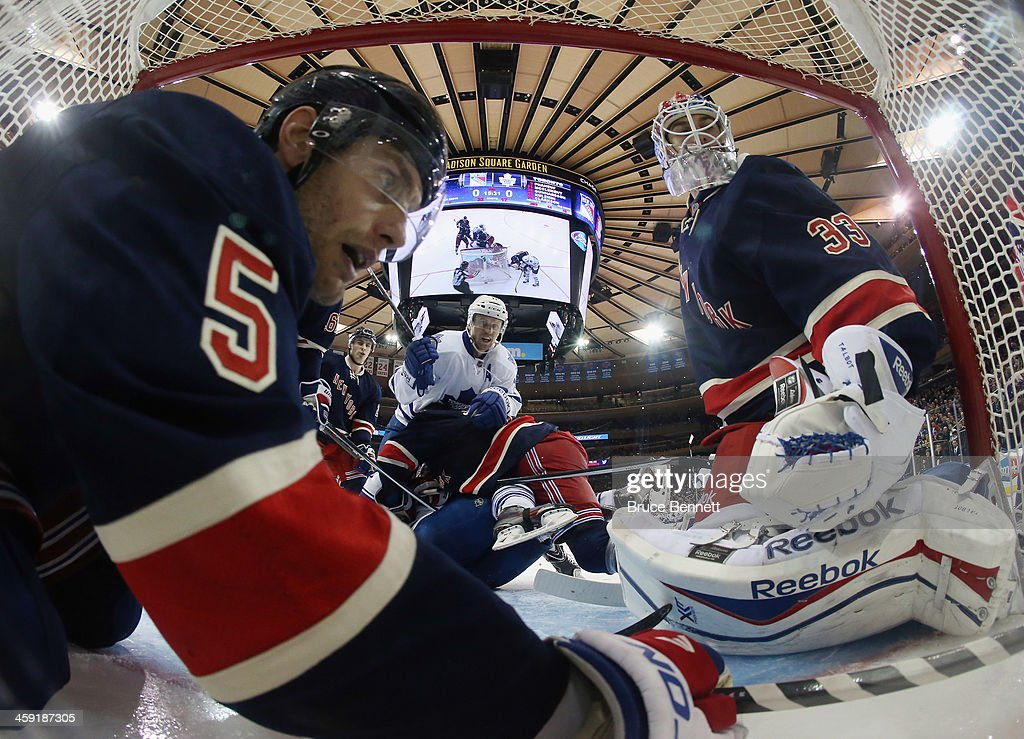 Dan Girardi #5 and <a gi-track='captionPersonalityLinkClicked' href=/galleries/search?phrase=Cam+Talbot&family=editorial&specificpeople=7185126 ng-click='$event.stopPropagation()'>Cam Talbot</a> #33 of the New York Rangers defend the net against <a gi-track='captionPersonalityLinkClicked' href=/galleries/search?phrase=Jay+McClement&family=editorial&specificpeople=575233 ng-click='$event.stopPropagation()'>Jay McClement</a> #11 of the Toronto Maple Leafs during the third period at Madison Square Garden on December 23, 2013 in New York City. The Rangers defeated the Maple Leafs 2-1 in the shootout.