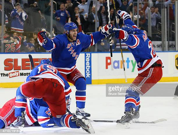 Dan Girardi and Ryan McDonagh of the New York Rangers celebarte the game winning goal against the Pittsburgh Penguins in Game Five of the Eastern...