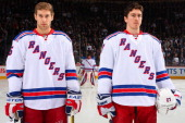 Dan Girardi and Ryan McDonagh of the New York Rangers stand on the blueline during the singing of the National anthems prior to NHL action against...