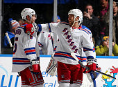 Dan Girardi and Tanner Glass of the New York Rangers celebrate the win over the New York Islanders on February 16 2015 at the Nassau Veterans...