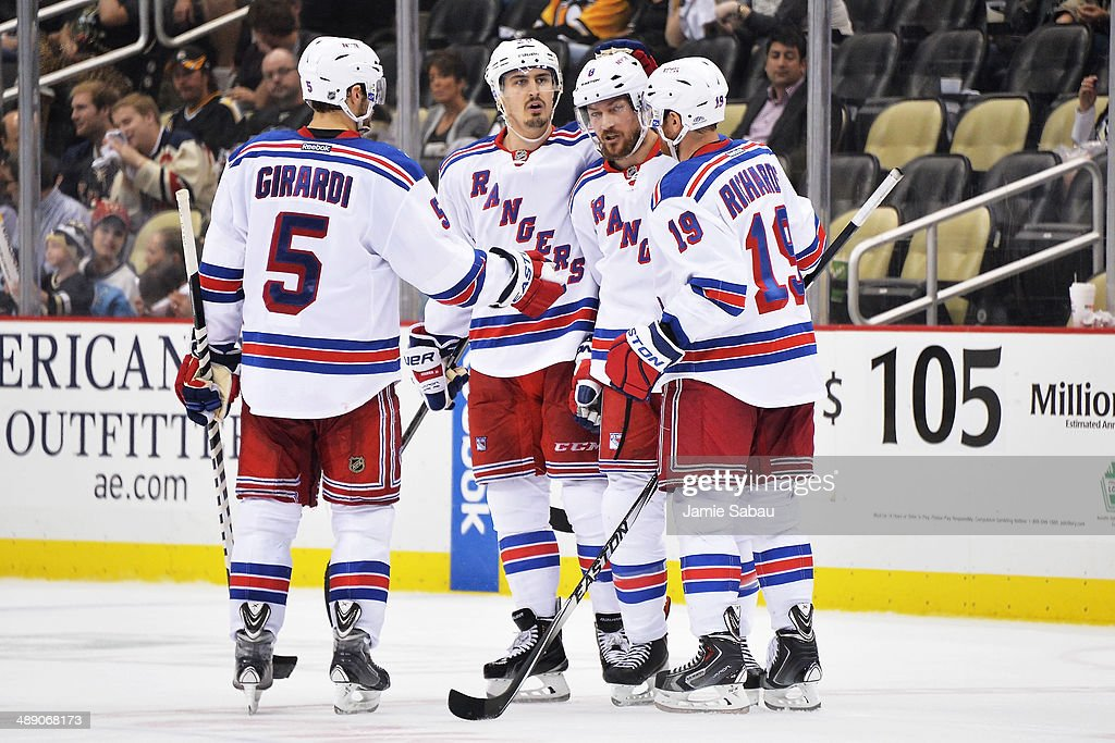 Dan Girardi #5, Chris Kreider #20 and Brad Richards #19 of the New York Rangers celebrate with Kevin Klein #8 after Klein's goal in the third period against the Pittsburgh Penguins in Game Five of the Second Round of the 2014 NHL Stanley Cup Playoffs on May 9, 2014 at CONSOL Energy Center in Pittsburgh, Pennsylvania. New York defeated Pittsburgh 5-1.
