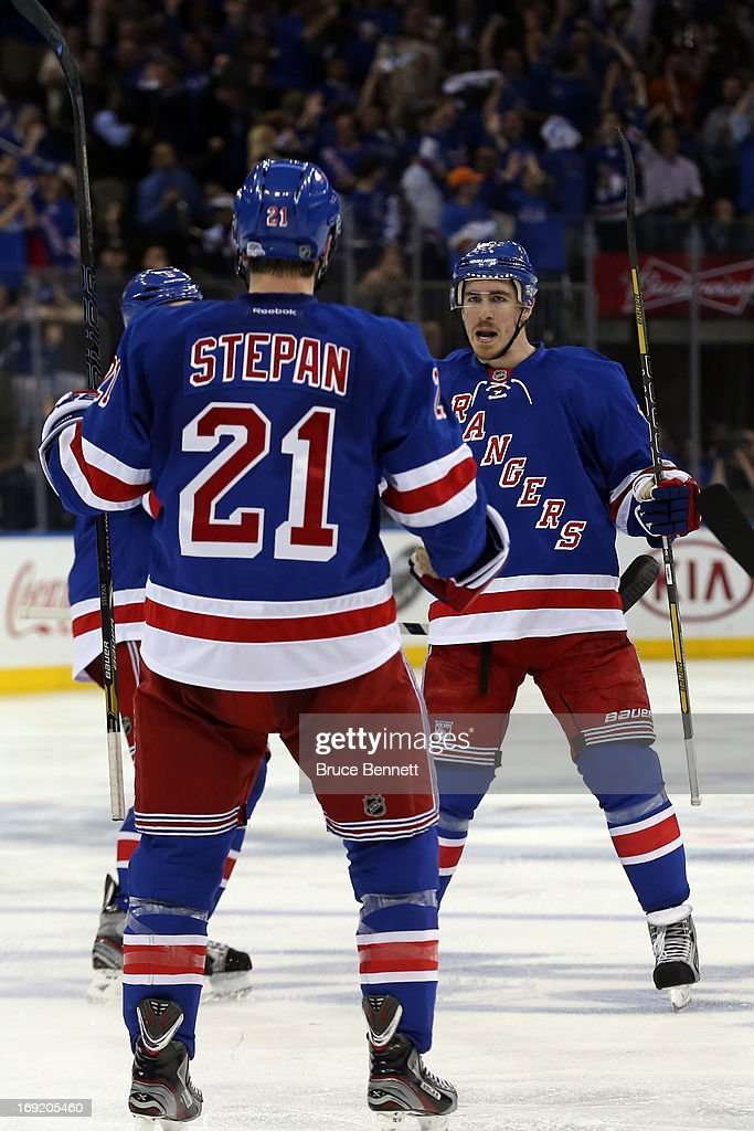 Dan Girardi #5, <a gi-track='captionPersonalityLinkClicked' href=/galleries/search?phrase=Derek+Stepan&family=editorial&specificpeople=4687181 ng-click='$event.stopPropagation()'>Derek Stepan</a> #21 and <a gi-track='captionPersonalityLinkClicked' href=/galleries/search?phrase=Ryan+McDonagh&family=editorial&specificpeople=4324983 ng-click='$event.stopPropagation()'>Ryan McDonagh</a> #27 of the New York Rangers celebate after Taylor Pyatt #14 of the New York Rangers scored a goal in the second period against Tuukka Rask #40 of the Boston Bruins in Game Three of the Eastern Conference Semifinals during the 2013 NHL Stanley Cup Playoffs at Madison Square Garden on May 21, 2013 in New York City.