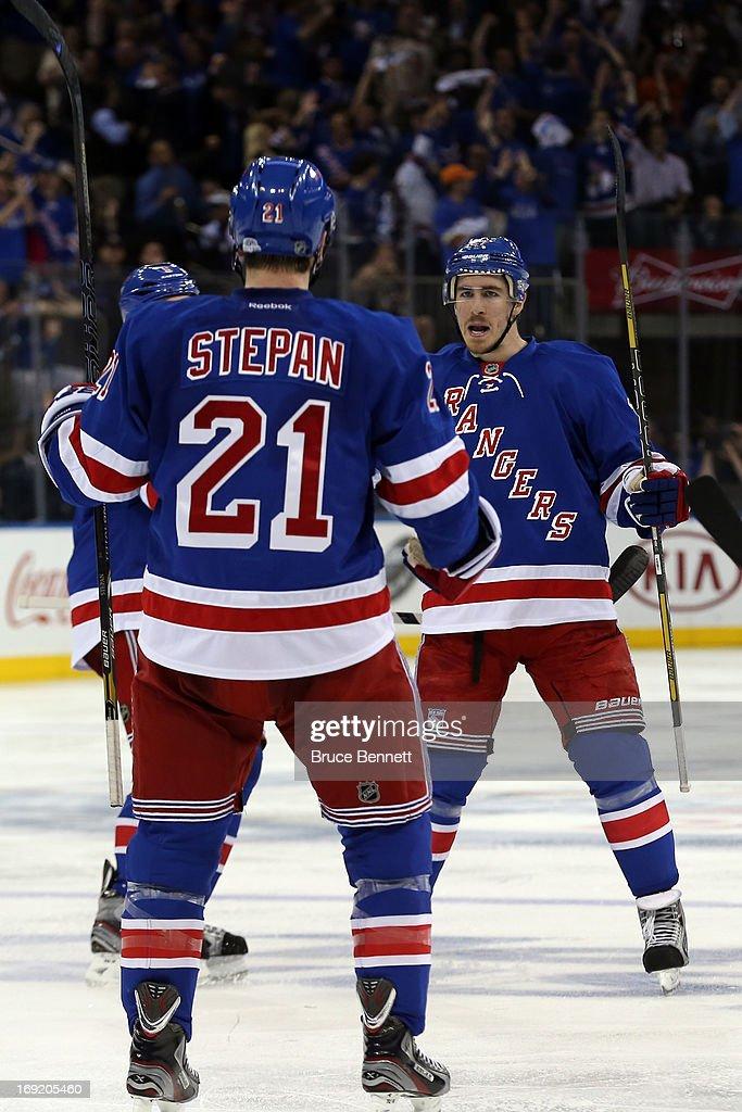 Dan Girardi Derek Stepan and Ryan McDonagh of the New York Rangers celebate after Taylor Pyatt of the New York Rangers scored a goal in the second...