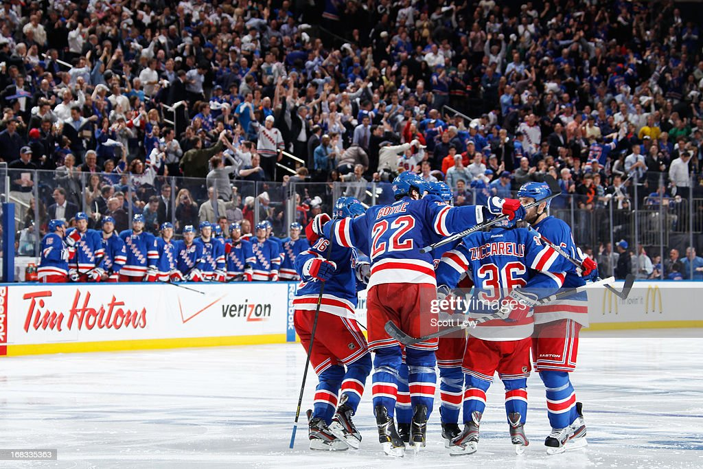 Dan Girardi #5, <a gi-track='captionPersonalityLinkClicked' href=/galleries/search?phrase=Mats+Zuccarello&family=editorial&specificpeople=7219903 ng-click='$event.stopPropagation()'>Mats Zuccarello</a> #36, and Brian Boyle #22 of the New York Rangers celebrate a third period goal against the Washington Capitals in Game Four of the Eastern Conference Quarterfinals during the 2013 NHL Stanley Cup Playoffs at Madison Square Garden on May 8, 2013 in New York City.