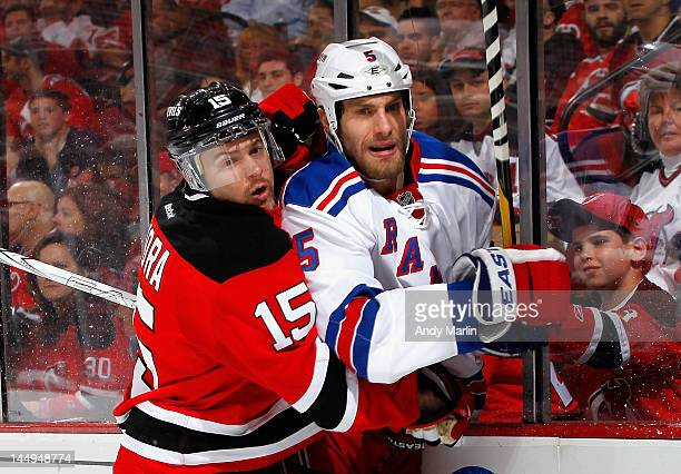 Dan Girardi of the New York Rangers and Petr Sykora of the New Jersey Devils battle along the boards in Game Three of the Eastern Conference Final...