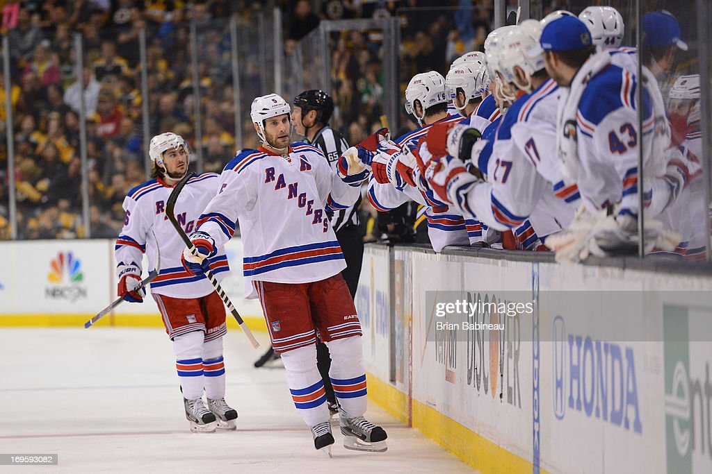 Dan Girardi #5 of the New York Rangers celebrates a goal against the Boston Bruins in Game Five of the Eastern Conference Semifinals during the 2013 NHL Stanley Cup Playoffs at TD Garden on May 25, 2013 in Boston, Massachusetts.