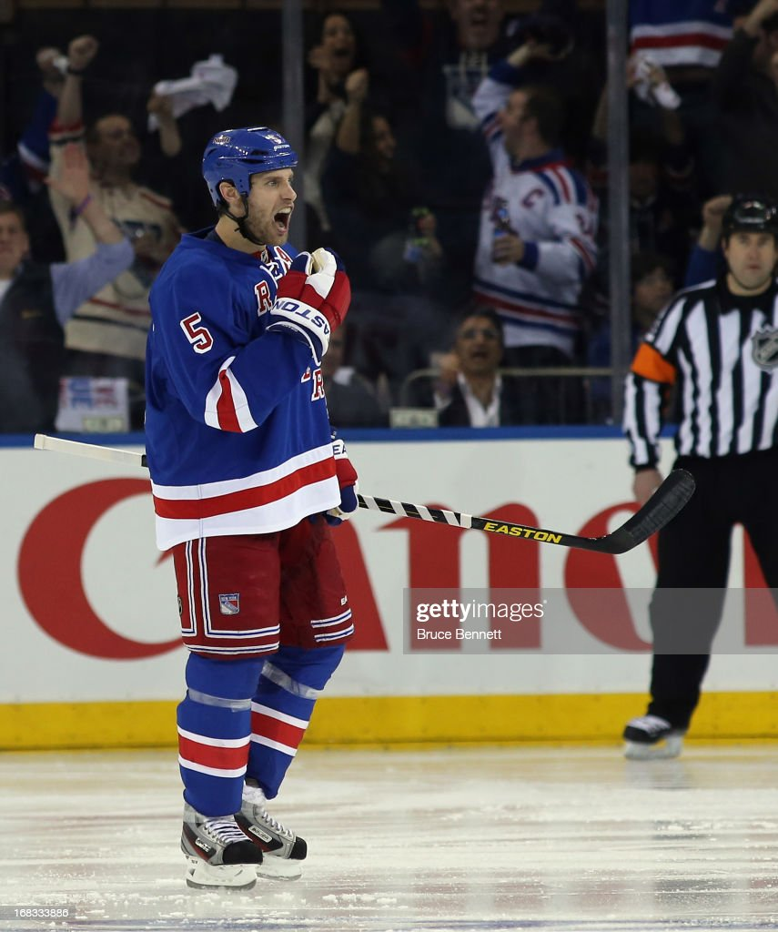 Dan Girardi #5 of the New York Rangers celebrates his powerplay goal at 59 seconds of the third period against the Washington Capitals in Game Four of the Eastern Conference Quarterfinals during the 2013 NHL Stanley Cup Playoffs at Madison Square Garden on May 8, 2013 in New York City. The Rangers defeated the Capitals 4-3.