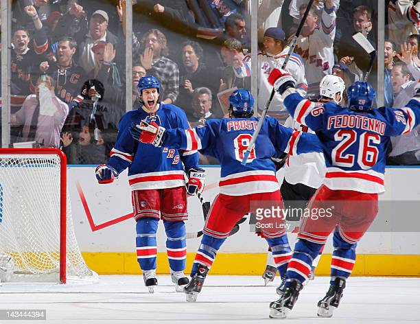 Dan Girardi of the New York Rangers celebrates his second period goal against the Ottawa Senators in Game Seven of the Eastern Conference...