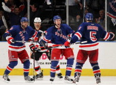 Dan Girardi of the New York Rangers celebrates ihs third period goal with teammates Derek Stepan and Marian Gaborik of the New York Rangers in Game...