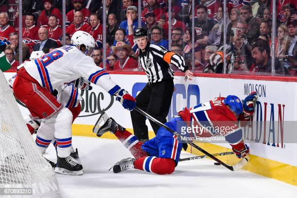 Dan Girardi of the New York Rangers pushes Alexander Radulov of the Montreal Canadiens into the boards in Game Five of the Eastern Conference First...