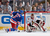 Dan Girardi of the New York Rangers scores a goal in the second period against Craig Anderson of the Ottawa Senators in Game Seven of the Eastern...