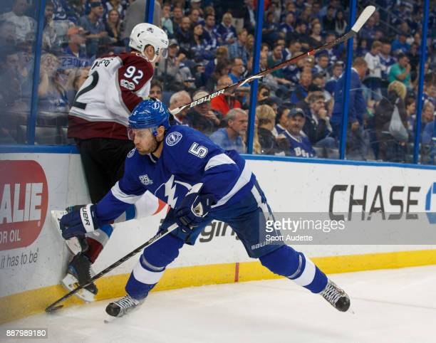 Dan Girardi of the Tampa Bay Lightning checksGabriel Landeskog of the Colorado Avalanche during the second period at Amalie Arena on December 7 2017...