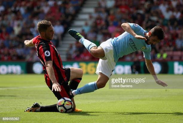 Dan Gosling of AFC Bournemouth fouls Bernardo Silva of Manchester City during the Premier League match between AFC Bournemouth and Manchester City at...