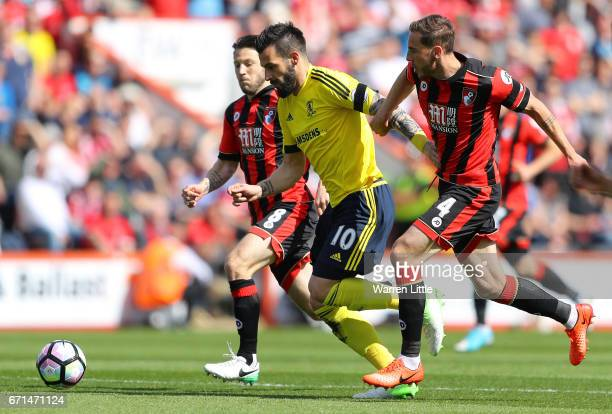 Dan Gosling of AFC Bournemouth pulls back Alvaro Negredo of Middlesbrough during the Premier League match between AFC Bournemouth and Middlesbrough...