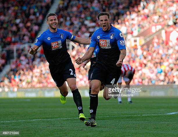 Dan Gosling of Bournemouth celebrates scoring his team's first goal with his team mate Simon Francis during the Barclays Premier League match between...