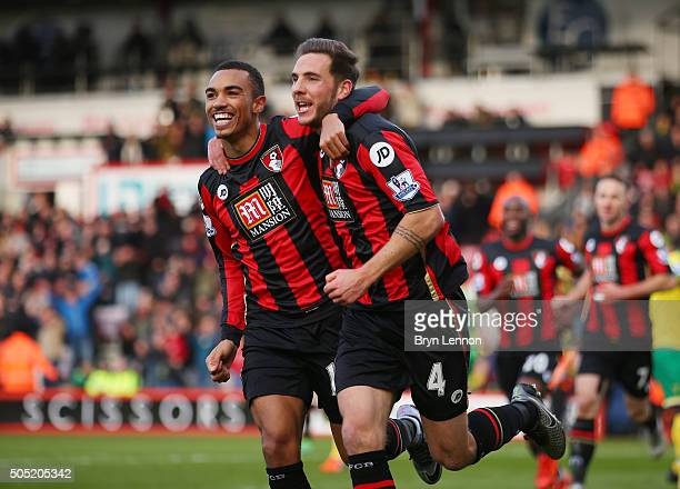 Dan Gosling of Bournemouth celebrates scoring his team's first goal with his team mate Junior Stanislas during the Barclays Premier League match...