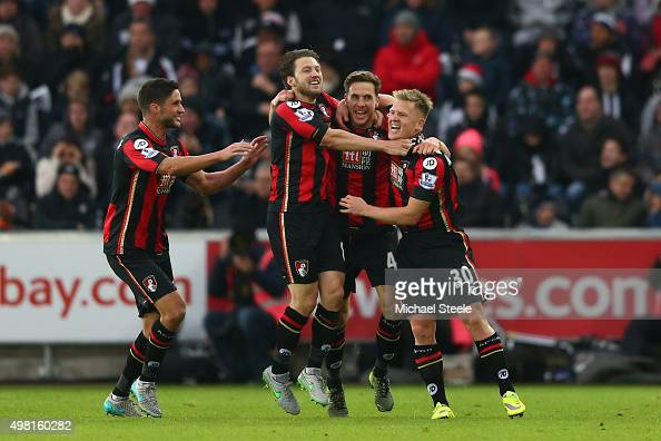 Dan Gosling of Bournemouth celebrates scoring his team's second goal with his team mates during the Barclays Premier League match between Swansea...