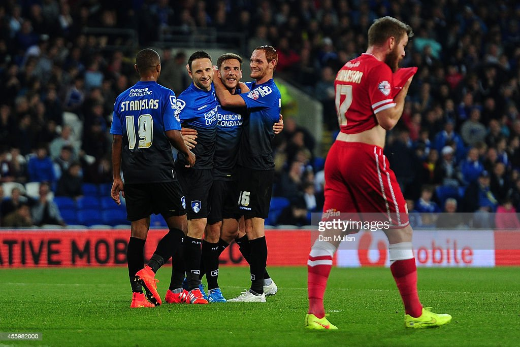 Dan Gosling of Bournemouth (C) celebrates with his team mates after scoring his side's third goal during the Capital One Cup third round match between Cardiff City and Bournemouth at Cardiff City Stadium on September 23, 2014 in Cardiff, Wales.