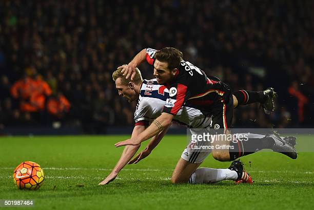 Dan Gosling of Bournemouth is fouled by Darren Fletcher of West Bromwich Albion in the penalty area during the Barclays Premier League match between...
