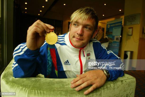Dan Greaves from Leicester with his gold medal in the discus arrives back at Gatwick airport with the British Paralympic team The British team won 94...