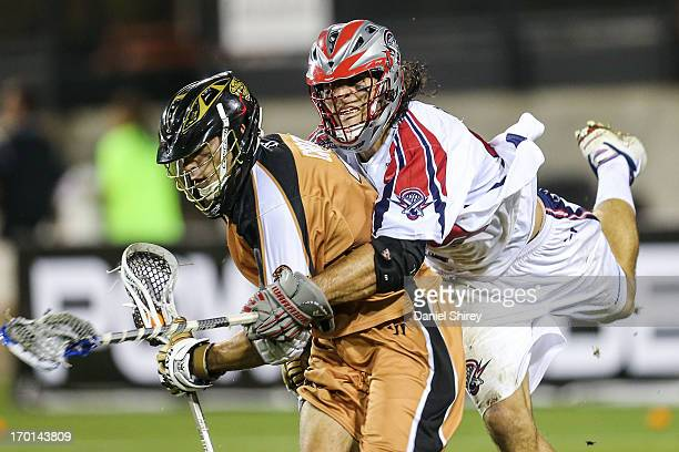Dan Groot of the Rochester Rattlers is held by Paul Rabil of the Boston Cannons in the second half at Fifth Third Bank Stadium on June 7 2013 in...