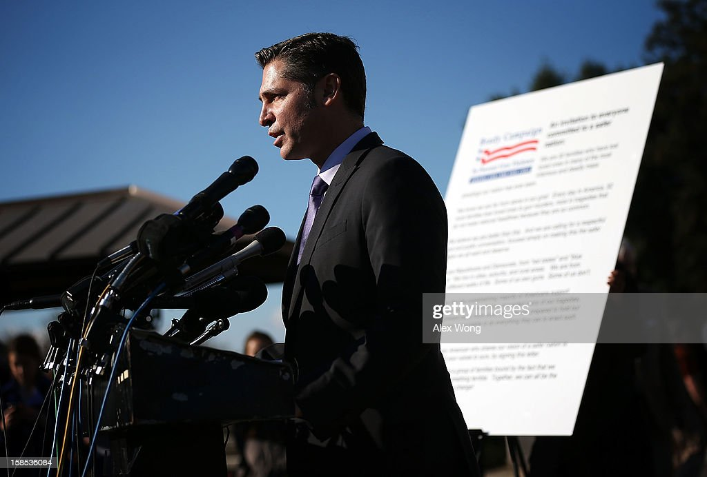 Dan Gross, president of the Brady Campaign, speaks during a news conference at the House Triangle on Capitol Hill December 18, 2012 in Washington, DC. U.S. Rep. David Cicilline (D-RI) (R) held a news conference with the Brady Campaign to discuss gun violence.