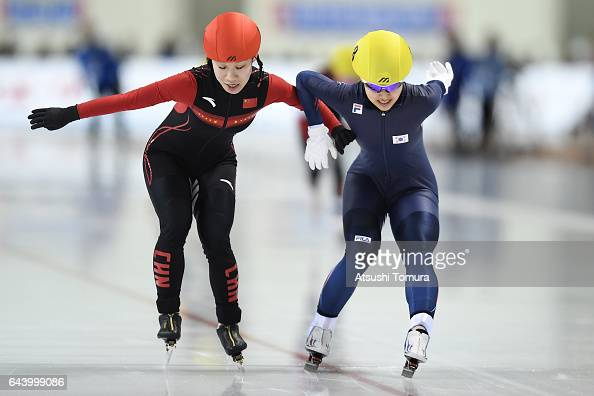 Dan Guo of China and BoReum Kim of South Korea compete to cross the finishing line in the speed skating ladies mass start on the day six of the 2017...