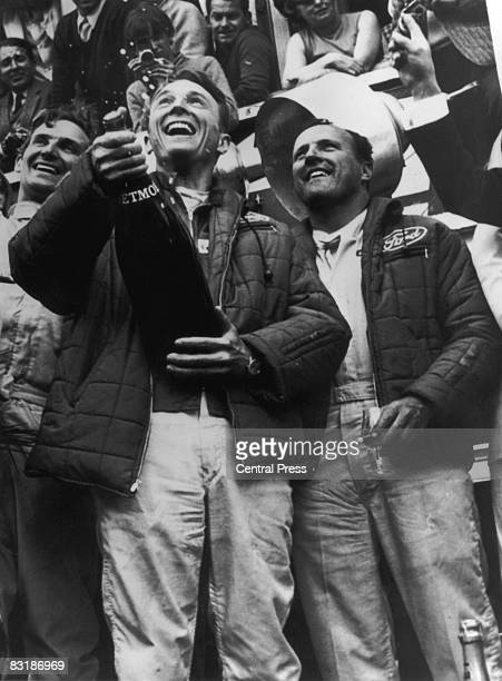 Dan Gurney and Anthony Foyt celebrate their win in the 24 Hour race at Le Mans 12th June 1967 They were driving a sevenlitre Ford
