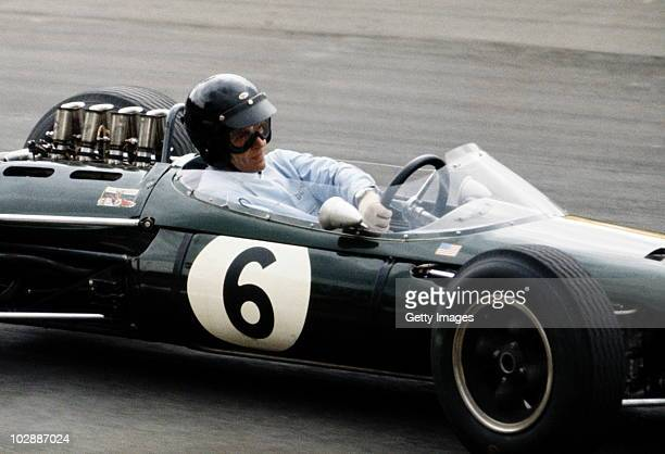 Dan Gurney drives the Brabham Racing Organisation Brabham BT7 Climax during the British Grand Prix on 11 July 1964 at the Brands Hatch circuit in...