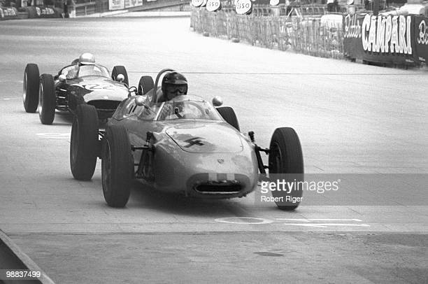 Dan Gurney drives the Porsche 718 ahead of John Surtees in the Cooper Climax T53 during the 1961 Grand Prix of Monaco on the Circuit de Monaco on May...