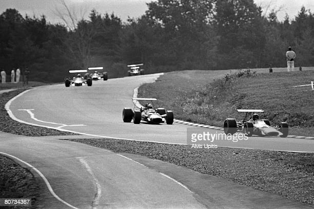 Dan Gurney in his McLaren M7A Formula One car leads Bobby Unser and others in qualifying for the United States Grand Prix held at Watkins Glen New...