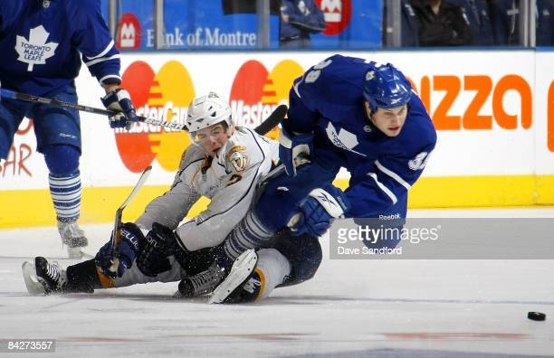Dan Hamhuis of Nashville Predators trips up John Mitchell of the Toronto Maple Leafs during their NHL game at the Air Canada Centre January 13 2009...