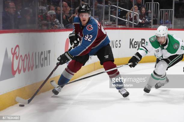 Dan Hamhuis of the Dallas Stars defends against Gabriel Landeskog of the Colorado Avalanche at the Pepsi Center on November 22 2017 in Denver...