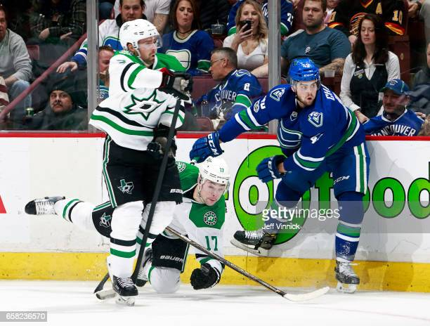 Dan Hamhuis of the Dallas Stars looks on as Michael Chaput of the Vancouver Canucks checks Devin Shore of the Dallas Stars during their NHL game at...