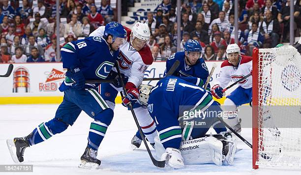 Dan Hamhuis of the Vancouver Canucks can't stop the puck from a shot by Max Pacioretty of the Montreal Canadiens from crossing the goal line behind...