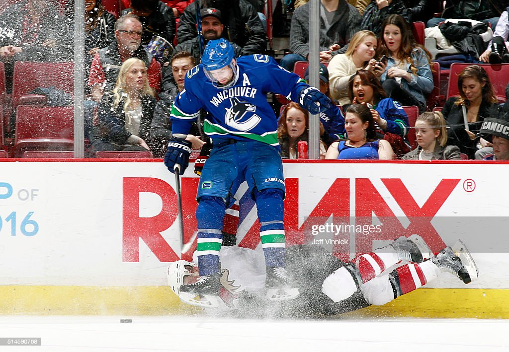 Dan Hamhuis #2 of the Vancouver Canucks checks Connor Murphy #5 of the Arizona Coyotes during their NHL game at Rogers Arena March 9, 2016 in Vancouver, British Columbia, Canada. Vancouver won 3-2 in overtime.