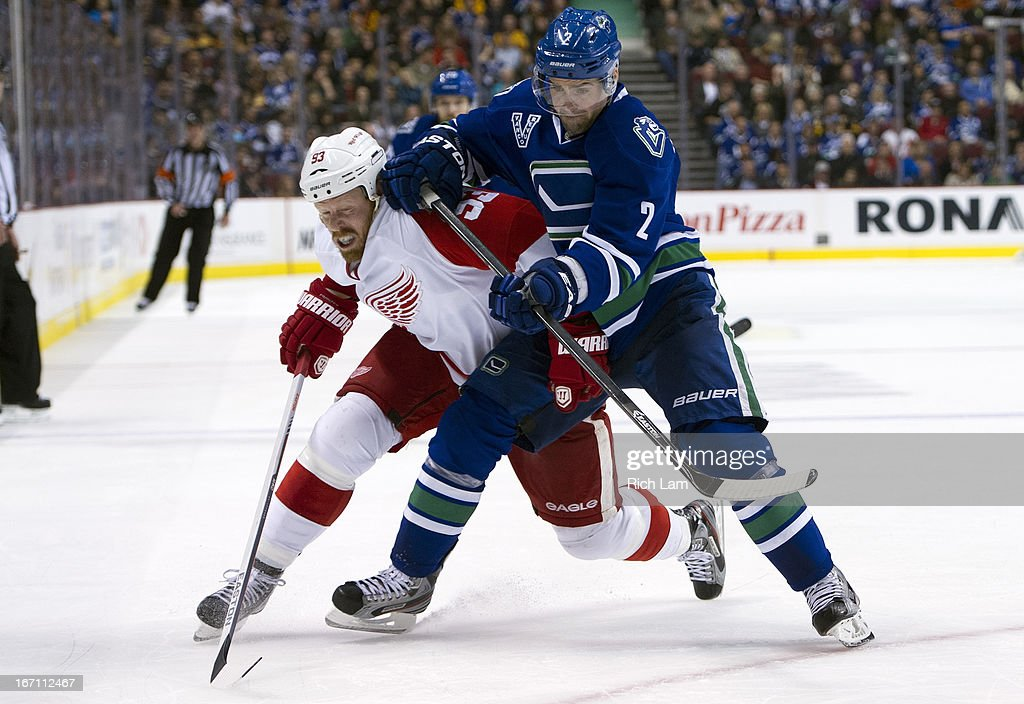 <a gi-track='captionPersonalityLinkClicked' href=/galleries/search?phrase=Dan+Hamhuis&family=editorial&specificpeople=204213 ng-click='$event.stopPropagation()'>Dan Hamhuis</a> #2 of the Vancouver Canucks gets tangled up with <a gi-track='captionPersonalityLinkClicked' href=/galleries/search?phrase=Johan+Franzen&family=editorial&specificpeople=624356 ng-click='$event.stopPropagation()'>Johan Franzen</a> #93 of the Detroit Red Wings while battling for position during the third period in NHL action on April 20, 2013 at Rogers Arena in Vancouver, British Columbia, Canada.