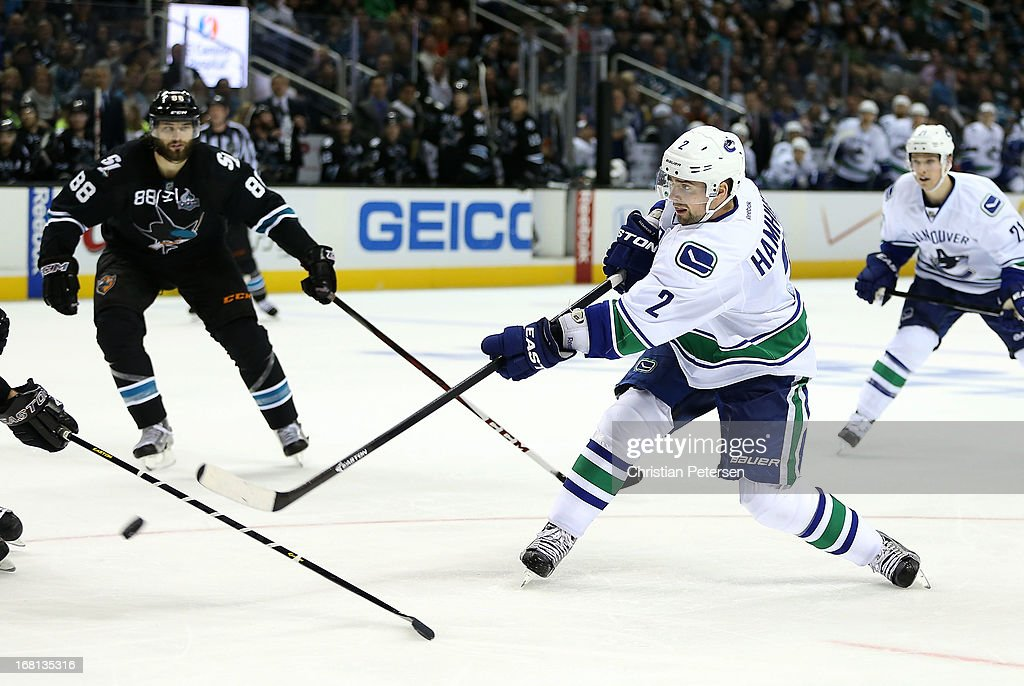 Dan Hamhuis #2 of the Vancouver Canucks shoots the score a third period goal against the San Jose Sharks in Game Three of the Western Conference Quarterfinals during the 2013 NHL Stanley Cup Playoffs at HP Pavilion on May 5, 2013 in San Jose, California. The Sharks defeated the Canucks 5-2.