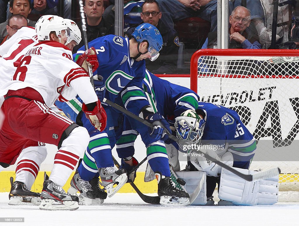 <a gi-track='captionPersonalityLinkClicked' href=/galleries/search?phrase=Dan+Hamhuis&family=editorial&specificpeople=204213 ng-click='$event.stopPropagation()'>Dan Hamhuis</a> #2 of the Vancouver Canucks watches <a gi-track='captionPersonalityLinkClicked' href=/galleries/search?phrase=Cory+Schneider&family=editorial&specificpeople=696908 ng-click='$event.stopPropagation()'>Cory Schneider</a> #35 of the Canucks make a save against the Phoenix Coyotes during an NHL game at Rogers Arena April 8, 2013 in Vancouver, British Columbia, Canada. Vancouver won 2-0.