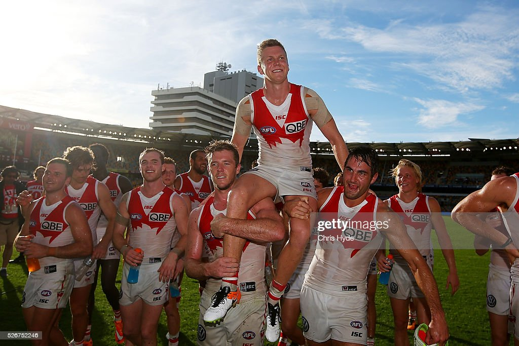 Dan Hanneberry of the Swans is chaired from the field after the round six AFL match between the Brisbane Lions and the Sydney Swans at The Gabba on May 1, 2016 in Brisbane, Australia.