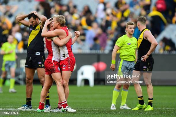 Dan Hannebery and Isaac Heeney of the Swans celebrate the win on the siren during the 2017 AFL round 13 match between the Richmond Tigers and the...