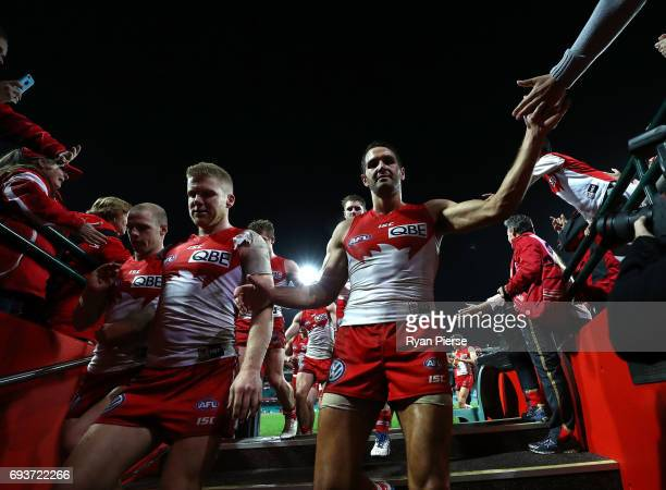 Dan Hannebery and Josh Kennedy of the Swans celebrate after the round 12 AFL match between the Sydney Swans and the Western Bulldogs at Sydney...