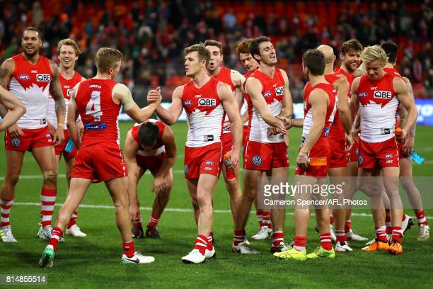 Dan Hannebery of the Swans and Luke Parker of the Swans celebrate winning the round 17 AFL match between the Greater Western Sydney Giants and the...