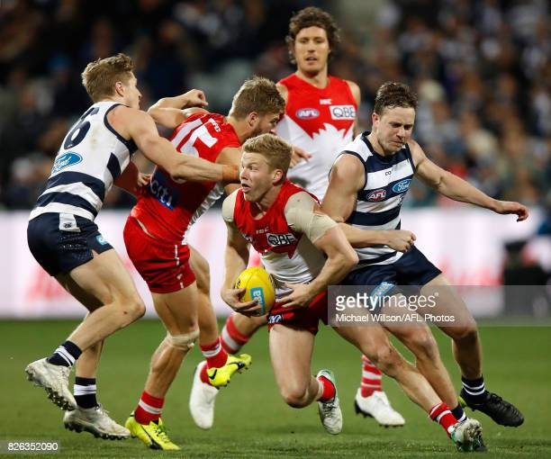 Dan Hannebery of the Swans and Mitch Duncan of the Cats compete for the ball during the 2017 AFL round 20 match between the Geelong Cats and the...