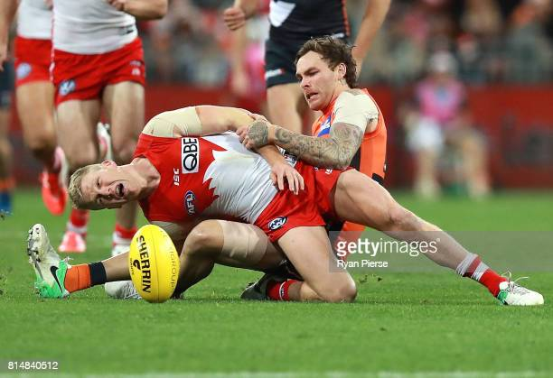 Dan Hannebery of the Swans is tackled by Nathan Wilson of the Giants during the round 17 AFL match between the Greater Western Sydney Giants and the...