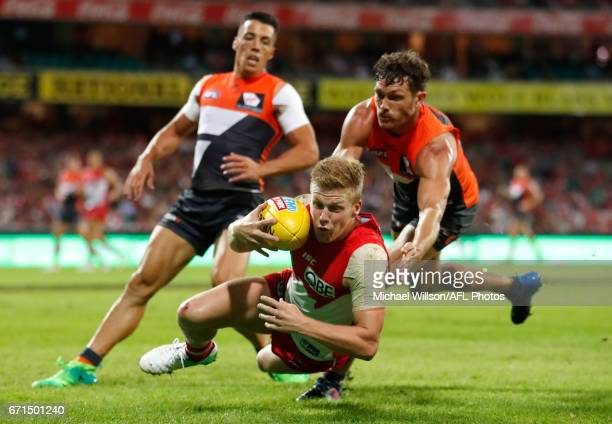 Dan Hannebery of the Swans is tackled by Sam Reid of the Giants during the 2017 AFL round 05 match between the Sydney Swans and the GWS Giants at the...