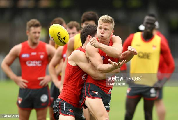 Dan Hannebery of the Swans is tackled during a Sydney Swans AFL training session at Lakeside Oval on March 1 2017 in Sydney Australia