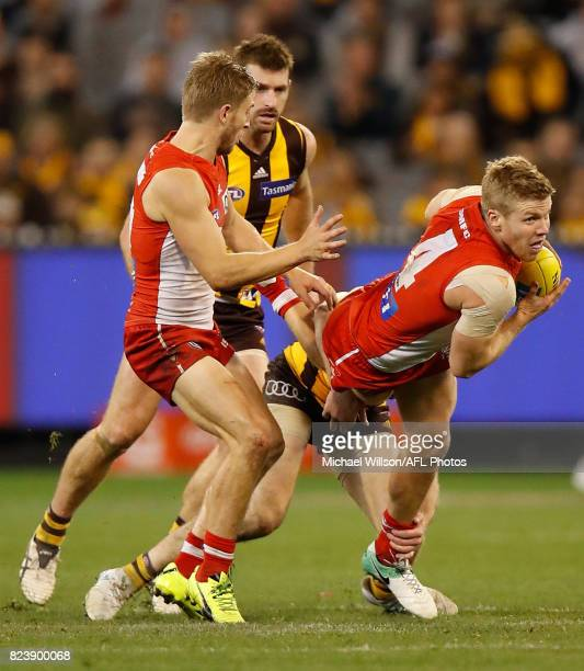 Dan Hannebery of the Swans is tackled during the 2017 AFL round 19 match between the Hawthorn Hawks and the Sydney Swans at the Melbourne Cricket...