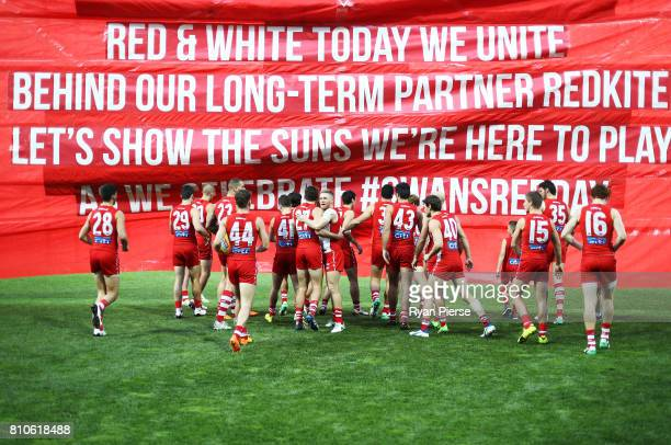 Dan Hannebery of the Swans leads his team out during the round 16 AFL match between the Sydney Swans and the Gold Coast Suns at Sydney Cricket Ground...